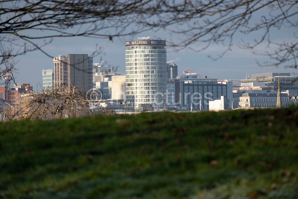 View from Calthorpe Park in Balsall Heath towards the City Centre and the iconic Rotunda building on 7th January 2021 in Birmingham, United Kingdom. Birmingham is undergoing a massive transformation called the Big City Plan which involves the controversial regeneration of the city centre as well as a secondary zone reaching out further. The Big City Plan is the most ambitious, far-reaching development project being undertaken in the UK. The aim for Birmingham City Council is to create a world-class city centre by planning for the next 20 years of transformation.