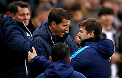 Watford manager Javi Gracia (centre) and Tottenham Hotspur manager Mauricio Pochettino greet each other before the match begins