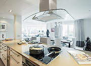 A show apartment in the Chelsea Creek development, part of Chelsea Habour in South West London.  Pic shows view of the kitchen and dining room in one of the larger units