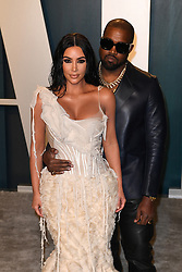 File photo dated February 09, 2020 of Kim Kardashian and Kanye West attending the Vanity Fair Oscar party at Wallis Annenberg Center for the Performing Arts in Beverly Hills, Los Angeles, CA, USA. US rapper Kanye West took to Twitter over the weekend to announce he was running for president, with his declaration quickly going viral and prompting a flurry of speculation. His wife Kim Kardashian West and entrepreneur Elon Musk endorsed him. Photo by David Niviere/ABACAPRESS.COM