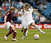 Photo: Chris Ratcliffe.<br /> Leeds United v Arsenal. Womens' FA Cup Final. 01/05/2006.<br /> Sue Smith (R) of Leeds is beats Leanne Champ of Arsenal to the ball.
