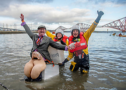 Thousands of people, many in fancy dress including Tony Pirouette from Dunfermline as 'man on the pan', with members of the RNLI Queensferry who were keeping the swimmers safe, took part in the annual Loony Dook New Years swim in the Firth of Forth at Queensferry in the shadow of the iconic Forth Bridges today.<br /> <br /> © Dave Johnston / EEm