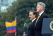 US President Bill Clinton stands with Colombian President Andres Pastrana during an arrival ceremony on the South Lawn of the White House October 28, 1998 in Washington DC.