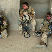 Aug 13, 2008 - Zhari District, Kandahar Province, Afghanistan - After a long battle in the Feyzollahkhan area, Canadian troops rest in an abandoned building in Zhari District, Kandahar Province, Afghanistan.(Credit Image: © Louie Palu/ZUMA Press)