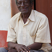 A Cuban man waiting patiently on the streets of Trinidad, Cuba.