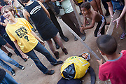 Children beat a doll pinhata with Ronaldos face on it, during a World Cup 2014 opening game event Brazil vs Croatia outdoors in favela Do Moinho, Sao Paulo, Brazil.