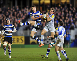 Ollie Devoto (Bath) and Chris Wyles (Saracens) compete for the ball in the air - Photo mandatory by-line: Patrick Khachfe/JMP - Tel: Mobile: 07966 386802 28/02/2014 - SPORT - RUGBY UNION - The Recreation Ground, Bath - Bath v Saracens - Aviva Premiership.