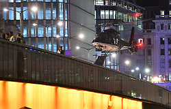 A second helicopter lands on London Bridge as police are responding to three incidents in the capital, amid reports that a vehicle collided with pedestrians on London Bridge, Scotland Yard said. Officers are dealing with reports of stabbings in Borough Market, where armed officers attended and shots were fired. They are also at an incident in the Vauxhall area.