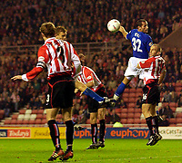 Photo. Jed Wee.<br /> Sunderland v Ipswich Town, Nationwide League Division One, Stadium of Light, Sunderland. 30/09/2003.<br /> Ipswich's Richard Naylor (partially concealed) heads Ipswich back on level terms.