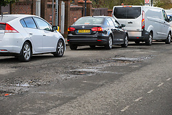 A series of potholes on Sidmouth Road in Willesden Green, west London, as the recent cold, wet weather has given rise to the increase in potholes and road surface deterioration in London. London, March 28 2018.