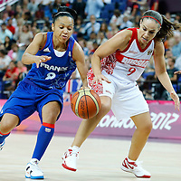 09 August 2012: Russia Becky Hammon vies for the loose ball with Edwige Lawson-Wade during 81-64 Team France victory over Team Russia, during the women's basketball semi-finals, at the 02 Arena, in London, Great Britain.