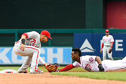 May 6, 2018 - Washington, DC, U.S. - WASHINGTON, DC - MAY 06:  Washington Nationals center fielder Michael Taylor (3) is thrown out attempting to steal second base as Philadelphia Phillies second baseman Cesar Hernandez (16) applies the tag during the game between the Philadelphia Phillies and the Washington Nationals on May 6, 2018, at Nationals Park, in Washington D.C.  The Washington Nationals defeated the Philadelphia Phillies, 5-4.  (Photo by Mark Goldman/Icon Sportswire) (Credit Image: © Mark Goldman/Icon SMI via ZUMA Press)