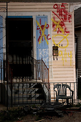 10 December, 05. New Orleans, Louisiana. Post Katrina aftermath. <br /> One dead in attic. The front porch of a house on St Roch in Gentilly where sadly a victim of the storm perished.<br /> Photo; ©Charlie Varley/varleypix.com