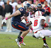 Oct. 22, 2011 - Charlottesville, Virginia - USA; Virginia Cavaliers defensive end Bill Schautz (47) goes after North Carolina State wide receiver T.J. Graham (6) during an NCAA football game at the Scott Stadium. NC State defeated Virginia 28-14. (Credit Image: © Andrew Shurtleff