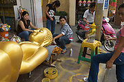 In the streets and alleyways around Bangkok's Giant Swing and Wat Suthat, giant bronze casts of buddha are made to adorn the Thai capital's buddhist temples, or wats.
