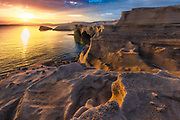 Rocky sea shore of Milos island at sunrise