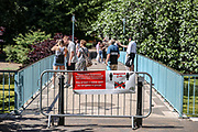 A sign requesting people stay two metres apart to try to reduce the spread of COVID-19 is displayed in a footbridge in St James' Park in London, Monday, June 22, 2020. The two-metre social distancing rule will be under review as the UK relax coronavirus lockdown measures implemented to stem the spread of the virus. (Photo/ Vudi Xhymshiti)