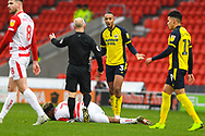 Cameron Borthwick-Jackson of Scunthorpe United (3) looks stunned as he is penalised for a foul on Mallik Wilks of Doncaster Rovers (7) during the EFL Sky Bet League 1 match between Doncaster Rovers and Scunthorpe United at the Keepmoat Stadium, Doncaster, England on 15 December 2018.