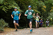 Kerhonkson, New York  - Runners follow the trail at the start of the 13.1-mile race at Minnewaska State park during the Shawangunk Ridge Trail Run/Hike on Sept. 16, 2017.