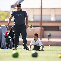 Father and son team of Renaldon Begay, left, and Zachery Begay, 10, watch to see where Zachery's throw lands in a game of unified team bocce at the Special Olympics qualifying event in Gallup, Saturday, May 4 at the Angelo Dipaolo Memorial Stadium.