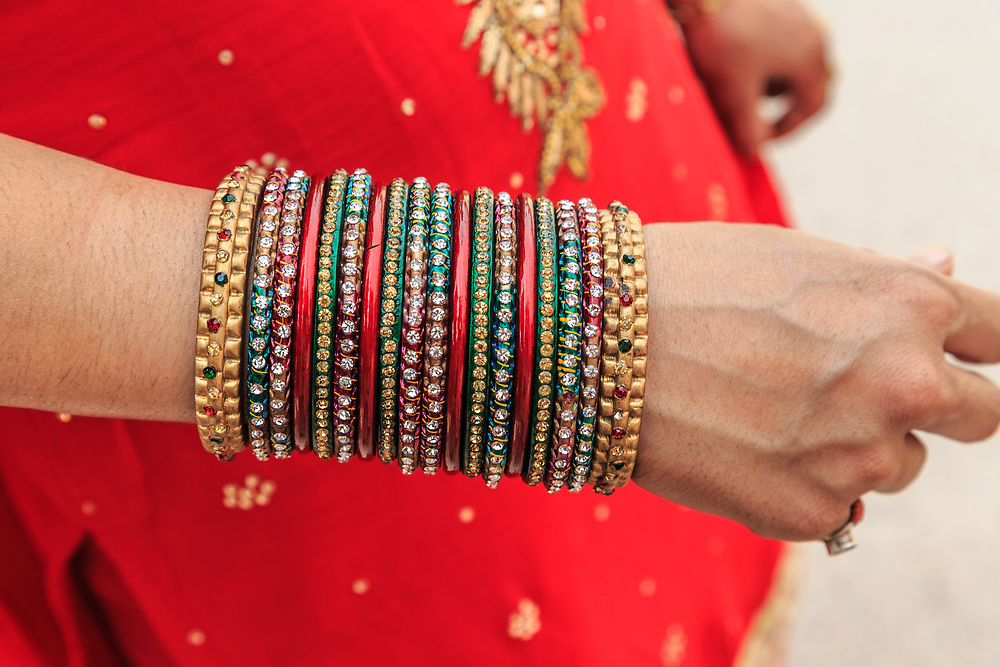Bangles on woman's hand in India. Bangles are rigid bracelets, usually from metal, wood, or plastic. A bangle is one of the most important ornaments that an Indian woman wears. For married women, bangles hold a special significance as they are a sign of their suhaag.