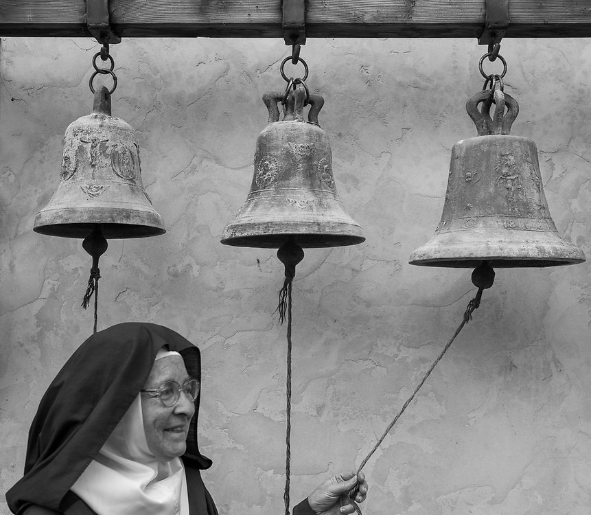 Mother Teresita rings bells from the 1800s behind the Carmelite Monastery in Carmel, Calif. on June 29, 2018 where she has been a cloistered nun for 57 years and serves at the current Mother Superior.