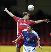 Photo: Jonathan Butler.<br />Swindon Town v Carlisle United. The FA Cup. 11/11/2006.<br />Derek Holmes of Carisle jumps for the ball with Andy Nicholas of Swindon.