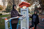 Ilknur Bayir (left) exercising with her friend and neighbour Aysel Yildimm (right) in Alparslan Park in Kayseri, central Turkey.