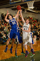 Winnisquam's Michael Buxton goes up for the basket against Kingswood's Michael Kelley during the boys finals of the 41st annual Holiday Basketball Tournament at Gilford High School Tuesday evening.  (Karen Bobotas/for the Laconia Daily Sun)