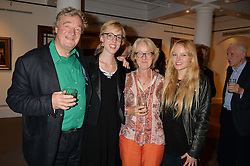 Left to right, CHRISTOPHER SIMON SYKES, VIRGINIA CAYZER, HENRIETTA CAYZER and ANGELICA CAYZER at a reception to celebrate the publication of Hockney - A Pilgrim's Progress by Christopher Simon Sykes held at Sotheby's, New Bond Street, London on 30th September 2014.