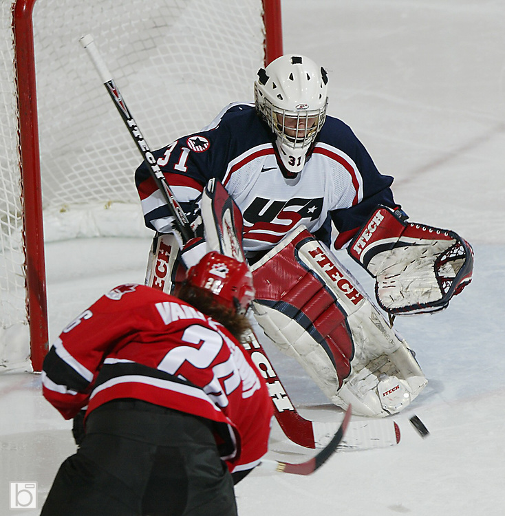 Team USA Goalie Pam Dryer makes a save against Canada's Sarah Vaillancourt during the second period  in the gold medal game at the Four Nations Cup in Lake Placid, N.Y., Sunday, November 14 2004.  Neither the US Team or Canada were able to score during the second period as the score remained 1-1.  (Photo/Todd Bissonette)