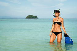 woman with snorkeling equipment standing in the water, Koh Lipe, Thailand