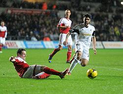 Fulham's Sascha Riether slides the ball away from Swansea City's Jordi Amat - Photo mandatory by-line: Alex James/JMP - Tel: Mobile: 07966 386802 28/01/2014 - SPORT - FOOTBALL - Liberty Stadium - Swansea - Swansea City v Fulham - Barclays Premier League