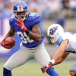 Wide receiver Hakeem Nicks #88 of the New York Giants dodges a tackle during second half NFL football action between the New York Giants and Tennessee Titans at New Meadowlands Stadium in East Rutherford, New Jersey. The Titans defeated the Giants .