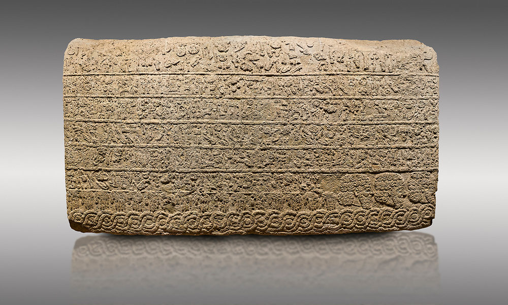 Picture & image of Hittite sculpted Orthostats panel from the  Long Wall.  Limestone, Kargarmis, Gaziantep, 900 - 700 BC,  Hieroglyph. Anatolian Civilisations Museum, Ankara, Turkey.<br /> <br /> In the epigraph with hieroglyph, he narrates that the gods were provoked against him, the account of the cities conquered and the spoils of war; that he allocated a share for the gods, and that he instigated the mighty king Tarhunza and the other gods. In the other lines, he demands that people should present offerings to statues but should evil-intentioned people be among them, such person individuals be punished by the gods.  <br /> <br /> On a gray background. .<br />  <br /> If you prefer to buy from our ALAMY STOCK LIBRARY page at https://www.alamy.com/portfolio/paul-williams-funkystock/hittite-art-antiquities.html  - Type  Karkamıs in LOWER SEARCH WITHIN GALLERY box. Refine search by adding background colour, place, museum etc.<br /> <br /> Visit our HITTITE PHOTO COLLECTIONS for more photos to download or buy as wall art prints https://funkystock.photoshelter.com/gallery-collection/The-Hittites-Art-Artefacts-Antiquities-Historic-Sites-Pictures-Images-of/C0000NUBSMhSc3Oo
