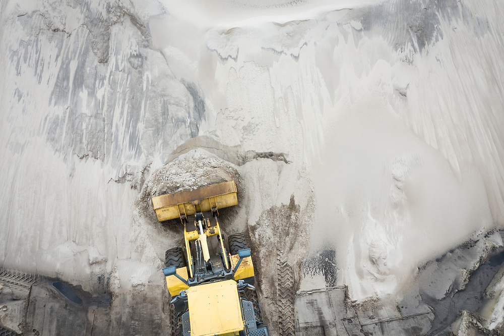 Aerial done image of an earth mover at a sand mine in Florida