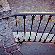 a Urban fence on Calle de Alacaia in downtown Madrid, Spain.