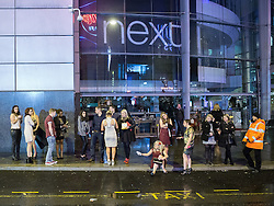 © Licensed to London News Pictures . 21/12/2013 . Manchester , UK . People queue for a taxi . Christmas revellers out in the rain in Manchester on Mad Friday , the last Friday night before Christmas which is typically one of the busiest nights of the year for police and ambulance crews . Photo credit : Joel Goodman/LNP