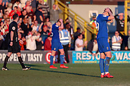 AFC Wimbledon striker Joe Pigott (39) and AFC Wimbledon defender Steve Seddon (15) with hands on head after final whistle during the EFL Sky Bet League 1 match between AFC Wimbledon and Charlton Athletic at the Cherry Red Records Stadium, Kingston, England on 23 February 2019.