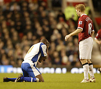 Photo: Aidan Ellis.<br /> Manchester United v Portsmouth. The FA Cup. 27/01/2007.<br /> Pompey's Lauren holds his face after clashing with United's Paul Scholes