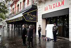 French President Francois Hollande and Paris' Mayor Anne Hidalgo unveil a commemorative plaque at the Bataclan concert hall in Paris on November 13, 2016, during a ceremony marking the first anniversary of the Paris terror attacks. 130 people were killed on November 13, 2015 by gunmen and suicide bombers from the Islamic State (IS) group in a series of coordinated attacks in and around Paris. Photo by Pool/ABACAPRESS.COM