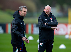 CARDIFF, WALES - Monday, March 29, 2021: Wales' care-taker manager Robert Page (R) and assistant coach Albert Stuivenberg during a training session at the Vale Resort ahead of the FIFA World Cup Qatar 2022 Qualifying Group E game against the Czech Republic. (Pic by David Rawcliffe/Propaganda)