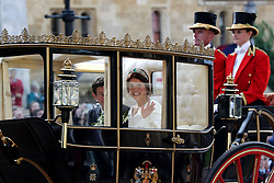 Jack Brooksbank and Princess Eugenie of York in a carriage after the wedding of Princess Eugenie to Jack Brooksbank at St George's Chapel in Windsor Castle.
