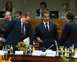 Nicolas Sarkozy, France's president, center, speaks with Silvio Berlusconi, Italy's prime minister, left, and an unidentified colleague, right,  during the European Summit meeting at EU Council headquarters in Brussels, Belgium, on Thursday, June 17, 2010. (Photo © Jock Fistick)