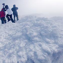 Photographers on ths summit of New Hampshire's Mount Washington in winter.