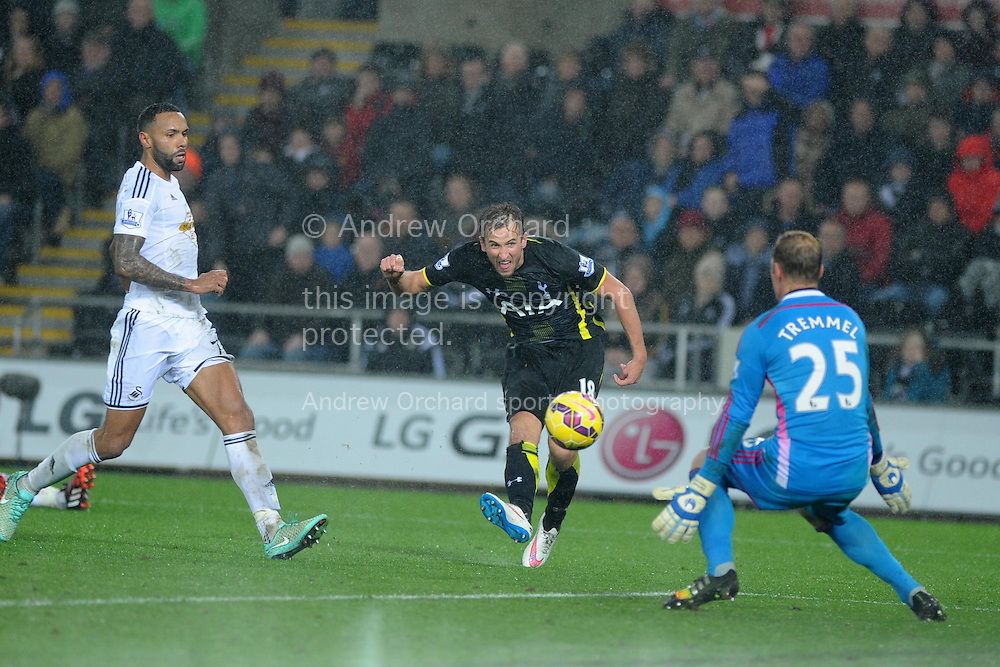 Harry Kane of Tottenham sees his shot at goal go wide of Swansea keeper Gerhard Tremmel.  Barclays Premier League match, Swansea city v Tottenham Hotspur at the Liberty Stadium in Swansea, South Wales on Sunday 14th December 2014<br /> pic by Andrew Orchard, Andrew Orchard sports photography.