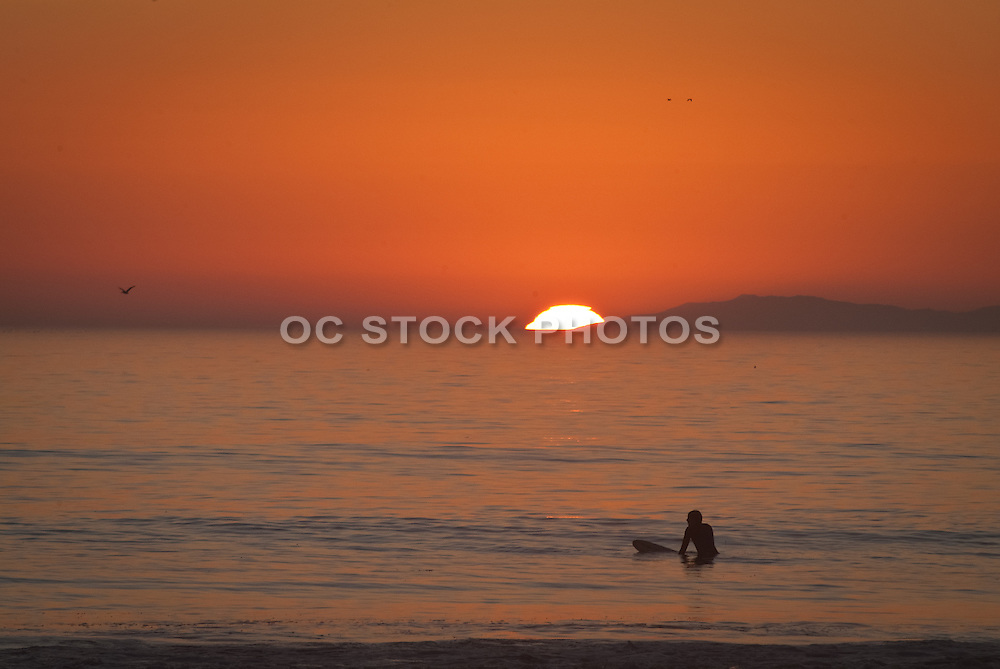 Surfer Waiting for a Wave at Sunset