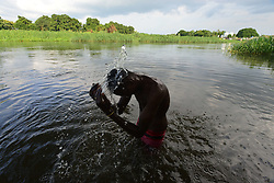 June 23, 2017 - Juba, Central Equatorial, South Sudan - A young Muslim man bathes in the Nile River to cope with the heat and the rigor of fasting as the Muslim holy month of Ramadan comes to an end. South Sudan, the world's newest nation, is a place where civilians have been devastated by a civil war that has left roughly two-thirds of the nation facing famine. (Credit Image: © Miguel Juarez Lugo via ZUMA Wire)