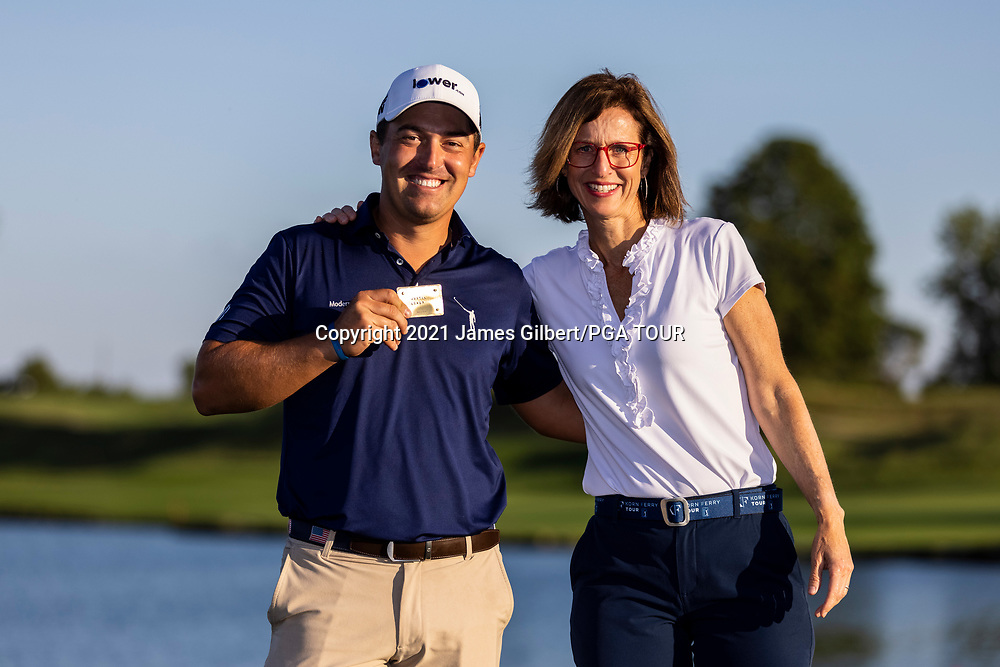 NEWBURGH, IN - SEPTEMBER 05: Alex Baldwin, President of the Korn Ferry Tour, poses for a photo with Justin Lower on the 18th green during the Finals 25 ceremony after the final round of the Korn Ferry Tour Championship presented by United Leasing and Financing at Victoria National Golf Club on September 5, 2021 in Newburgh, Indiana. (Photo by James Gilbert/PGA TOUR via Getty Images)