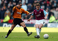 Photo. Matthew Lewis.<br /> Wolverhampton Wanderers v West Ham United. FA Cup 4th Round. 25/01/2004.<br /> <br /> West Hams' David Connolly holds off Wolves' Silas.
